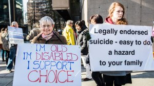 Pro-assisted suicide supporters and anti-assisted suicide supporters rally outside the BC Supreme Court in Vancouver, British Columbia, Monday March 4, 2013, The Federal Government appeals a B.C. Supreme Court decision that struck down Canada's ban on assisted suicide. Through March 8, Rallies are organized outside Supreme Court for Carter vs Canada.   Photo By CARMINE MARINELLI/Vancouver 24hrs/QMI AGENCY
